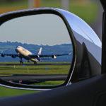 Aeroplane in car wing mirror